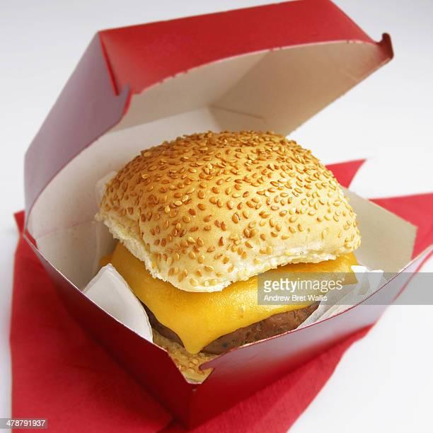 Cheeseburger in an open takeaway carton