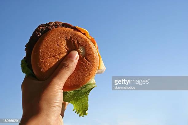 Cheeseburger in hand-Diät Smiet!