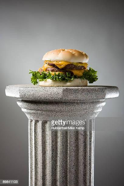 cheeseburger on a pedestal