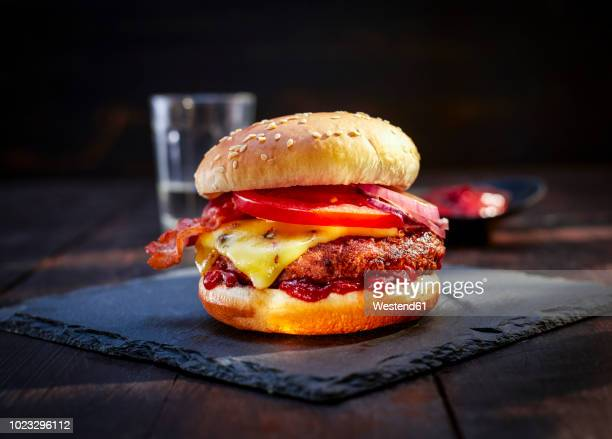 cheeseburger with bacon on slate - burger stock pictures, royalty-free photos & images