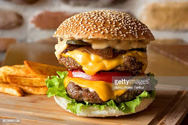 cheeseburger with french fries - hamburger stock pictures, royalty-free photos & images