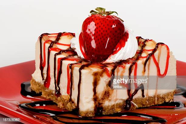 Cheesecake drizzled with chocolate caramel and strawberry