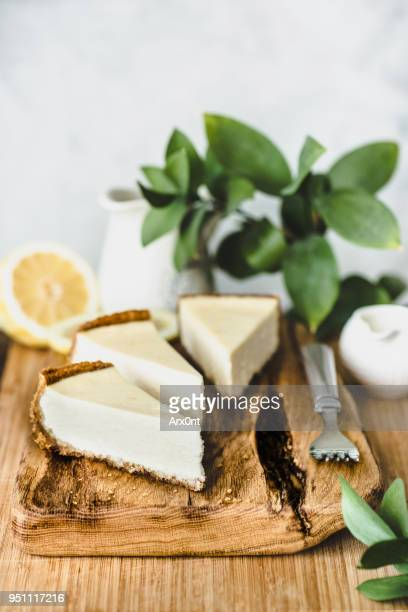 cheesecake on wooden board - cheesecake stock pictures, royalty-free photos & images