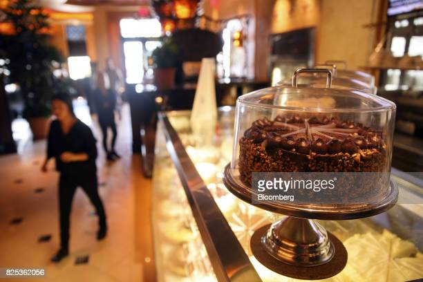 A cheesecake sits on a display case at a Cheesecake Factory Inc restaurant in the Canoga Park neighborhood of Los Angeles California US on Tuesday...