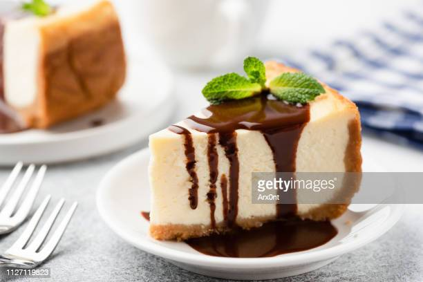 cheesecake with chocolate sauce on plate - dessert stock pictures, royalty-free photos & images