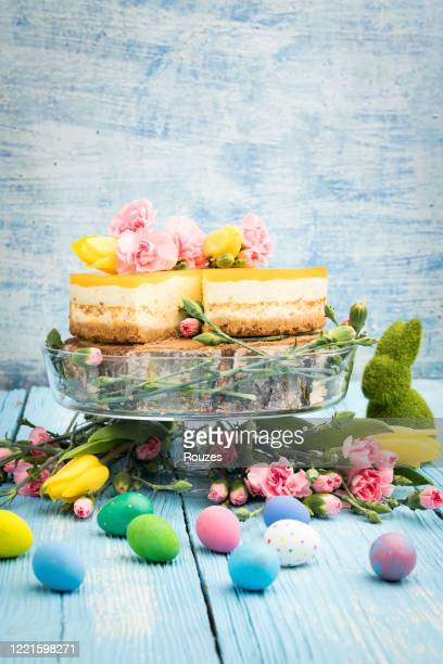 cheesecake with easter eggs on blue background - easter cake stock pictures, royalty-free photos & images