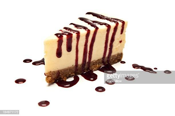 Cheesecake with sauce dripping on white background