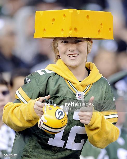A cheesehead fan of the Green Bay Packers smiles during their game against the New York Jets at New Meadowlands Stadium on October 31 2010 in East...