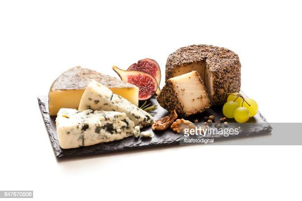 cheeses board on white background - tapas stock photos and pictures