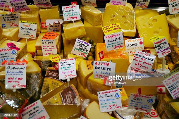 Cheeses on delicatessen market stall