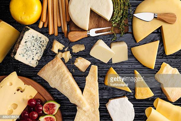 cheeses selection - delicatessen stock pictures, royalty-free photos & images