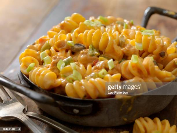 cheesy, chili rotini - macaroni and cheese stock photos and pictures