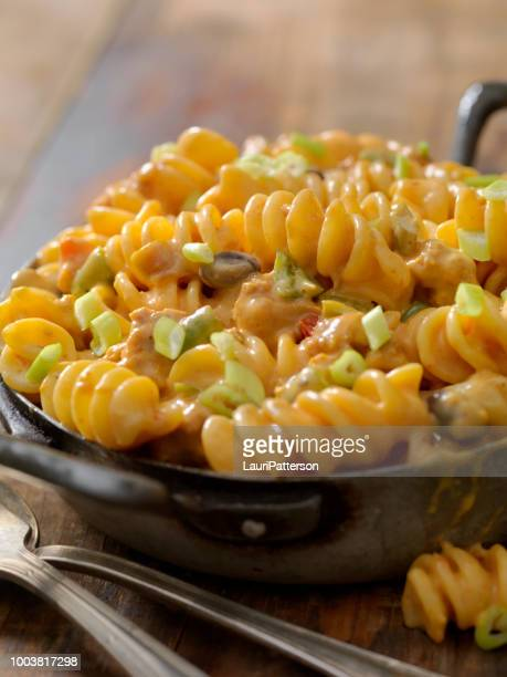 cheesy, chili rotini - cheese sauce stock photos and pictures