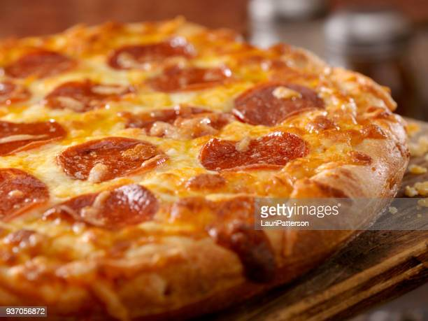 cheesy pepperoni pizza - pepperoni pizza stock photos and pictures