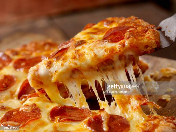 cheesy pepperoni pizza - cheese stock pictures, royalty-free photos & images