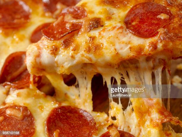 cheesy pepperoni pizza - pepperoni pizza stock pictures, royalty-free photos & images