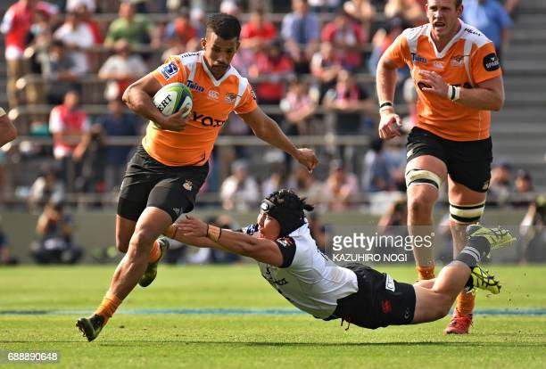 Cheetahs fullback Clayton Bloometjies avoids a tackle during the Super Rugby match between the Sunwolves of Japan and the Cheetahs of South Africa at...