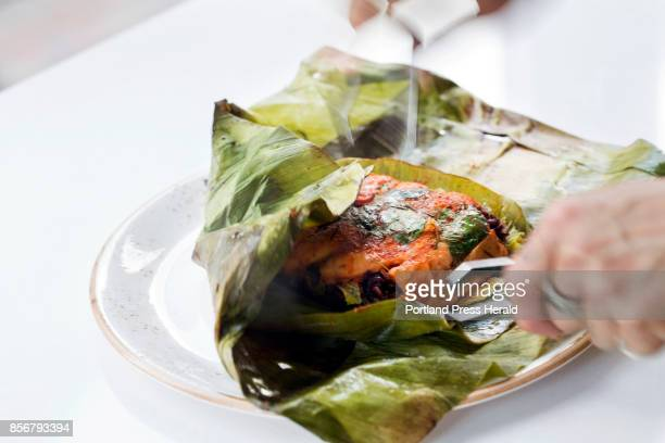 Cheevitdee server Nik Thonglamun reveals Ping Ngob salmon napa basil and riceberry wrapped in banana leaves