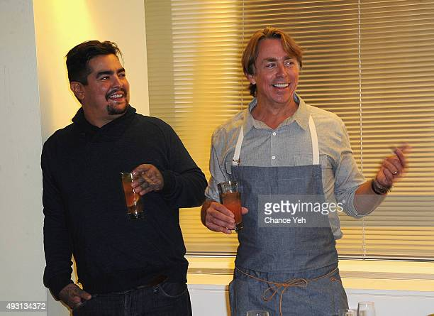 Chef Aaron Sanchez and Chef John Besh attend the Besh Big Easy Hosted By John Besh And Mark Oldman Pairing Seminar Hosted By FOOD WINE during Food...