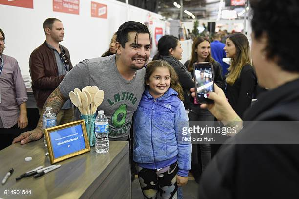 Chef Aaron Sanchez greets fans at the Food Network Cooking Channel New York City Wine Food Festival Presented By CocaCola Grand Tasting presented by...