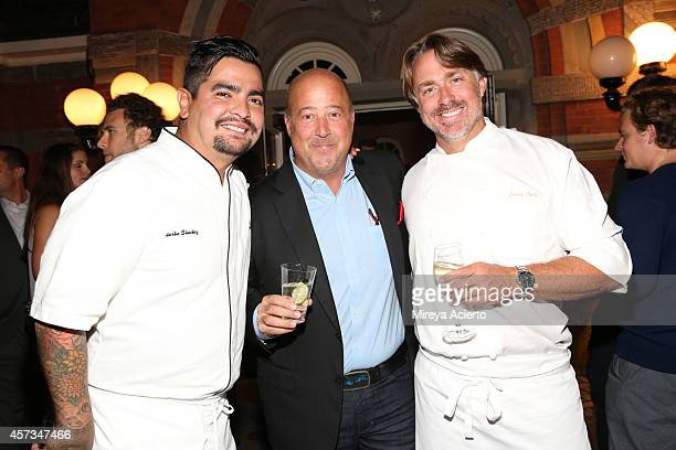 Chef Aaron Sanchez tv personality Andrew Zimmern and chef John Besh pose at the Johnny Sanchez Dinner hosted by John Besh Aaron Sanchez and Katy...