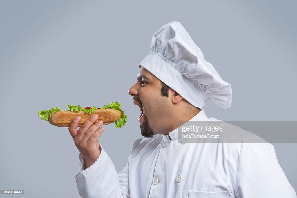 Chef about to eat a sandwich : Stock Photo