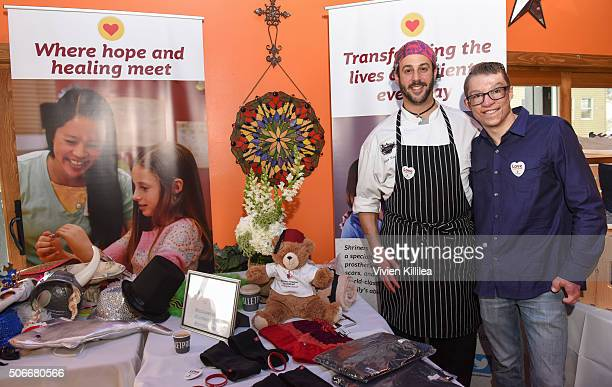 Chef Adam Kreisel and Shriners Hospital for Children patient ambassador Marius Woodward and attend EcoLuxe Lounge at Sundance16 on January 24 2016 in...
