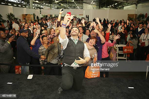 Chef Adam Richman poses on stage at the Grand Tasting presented by ShopRite featuring KitchenAid® culinary demonstrations presented by MasterCard...
