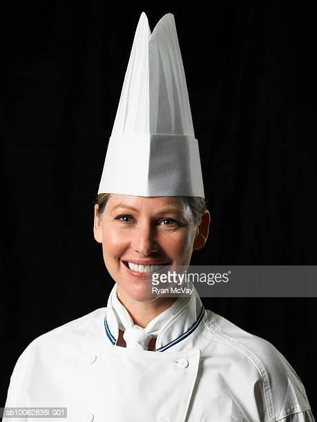 Chef against black background, portrait