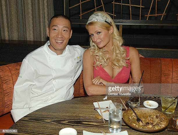 Chef Akira Back and Paris Hilton attend the grand opening celebration of Yellowtail Sushi Restaurant Bar At Bellagio Hotel and Casino Resort on...