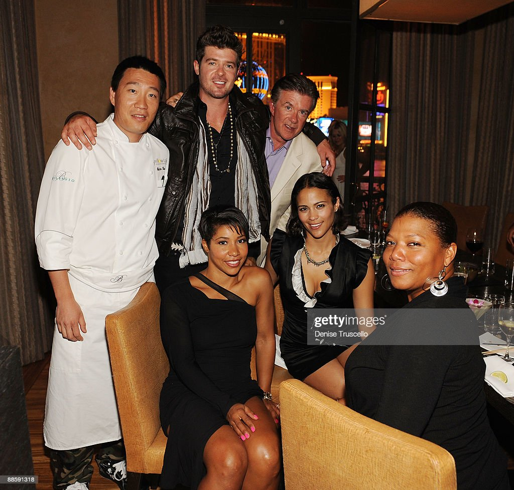 Chef Akira Back, Robin Thicke, Alan Thicke, (front L-R) Paula Patton and Queen Latifah attend Yellowtail restaurant at the Bellagio Las Vegas on June 19, 2009 in Las Vegas, Nevada.