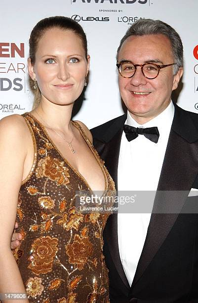 Chef Alain Ducasse and friend Gwenaelle Gueguen pose backstage at the 2002 GQ Men of the Year Awards October 16 2002 at the Manhattan Center in New...