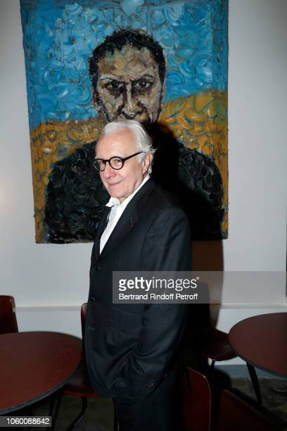 Chef Alain Ducasse poses in front of a portrait of Azzedine Alaia by Julian Schnabel during Alaia Foundation Library Opening at Gallery Azzedine...
