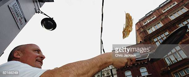 Chef Aldo Zilli breaks the world record for the highest pancake toss 329cm during the Mick Brown Breakfast Show on Capital Gold radio outside the...