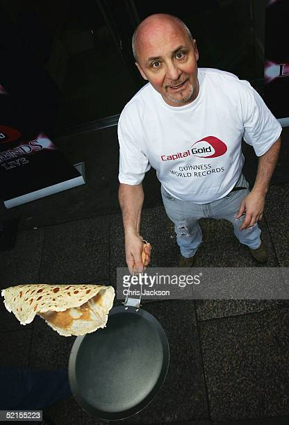 Chef Aldo Zilli demonstrates his 'tossing' technique after breaking the world record for the highest pancake toss 329cm during the the Mick Brown...