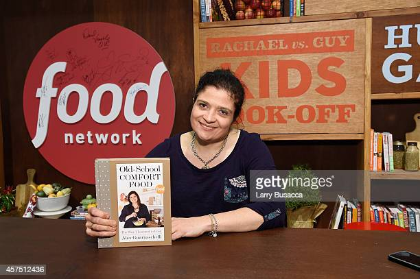 Chef Alex Guarnaschelli signs copies of her book 'OldSchool Comfort Food The Way I Learned to Cook' at the Grand Tasting presented by ShopRite...