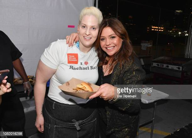 Chef Allison Fasano and Rachael Ray pose with her signature burger during the Food Network Cooking Channel New York City Wine Food Festival presented...