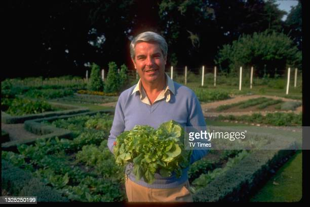 Chef and cookery writer Robert Carrier in the vegetable garden outside his restaurant at Hintlesham Hall in Suffolk, circa 1980.