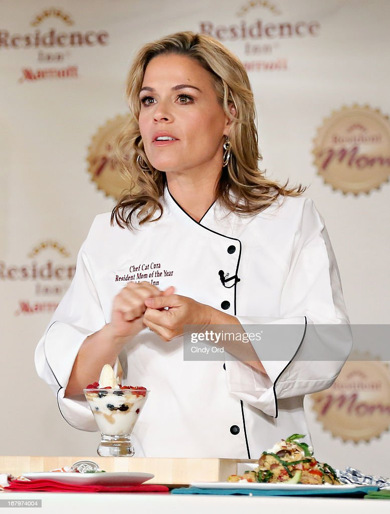 Chef and lifestyle entrepreneur Cat Cora conducts a cooking demonstration after recieving the 2013 Resident Mom of the Year award at Residence Inn by Marriott on May 3, 2013 in New York City.