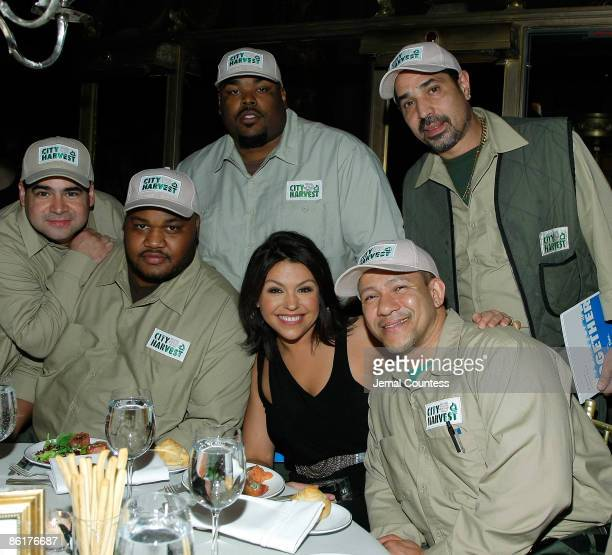 Chef and media personality Rachael Ray poses with City Harvest food Delivery Drivers during An Evening of Practical Magic hosted by City Harvest at...