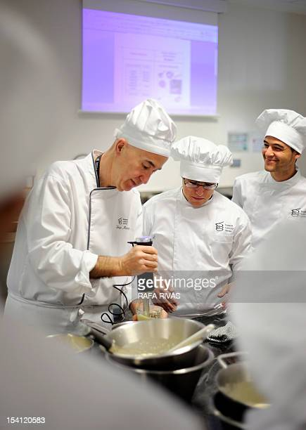 Chef and teacher Inigo Murua gives a class at the Basque Culinary Centre on October 4 in the Northern Spanish Basque city of San Sebastian Ham with...