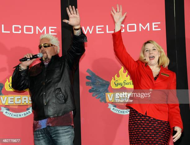 Chef and television personality Guy Fieri and Regional President of The Quad Resort Casino Eileen Moore wave to guests during a welcome event for Guy...