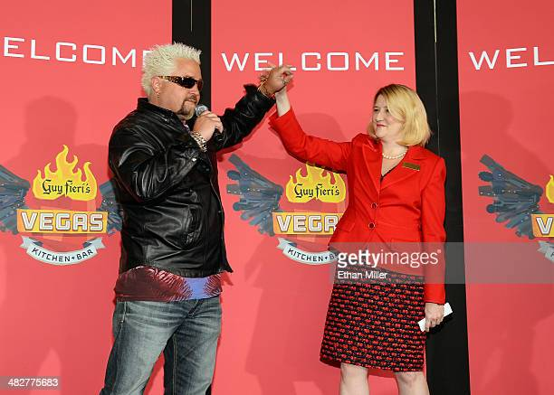 Chef and television personality Guy Fieri and Regional President of The Quad Resort Casino Eileen Moore talk to guests during a welcome event for Guy...