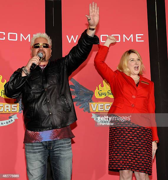 Chef and television personality Guy Fieri and Regional President of The Quad Resort Casino Eileen Moore greet guests during a welcome event for Guy...