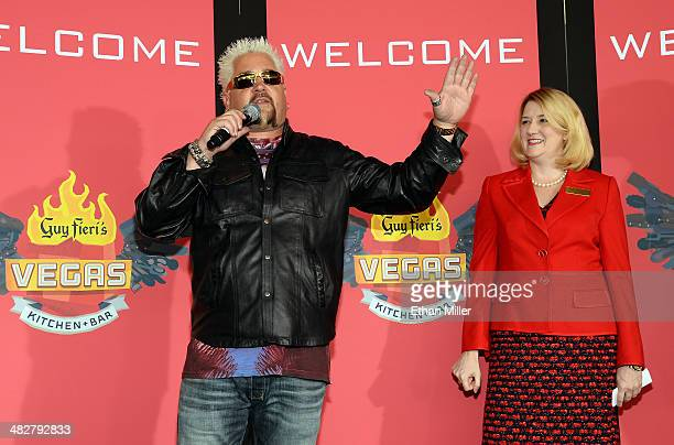 Chef and television personality Guy Fieri and Regional President of The Quad Resort Casino Eileen Moore speak to guests during a welcome event for...