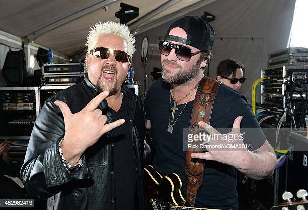 Chef and television personality Guy Fieri and singer Lee Brice pose backstage during day two of the ACM Party for a Cause Festival at The LINQ on...