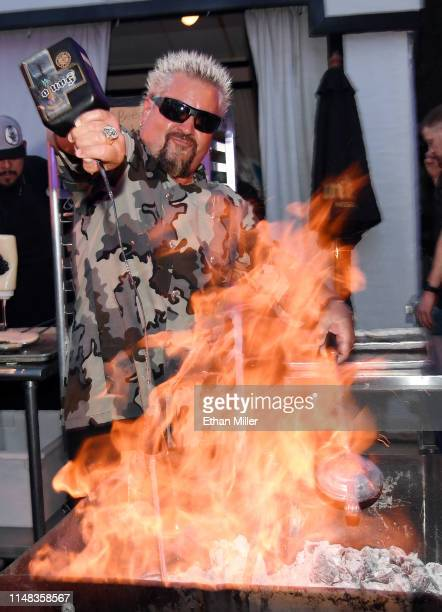 Chef and television personality Guy Fieri prepares food using Santo Puro Mezquila at the Guy Fieri's Vegas Kitchen Bar booth at the 13th annual Vegas...