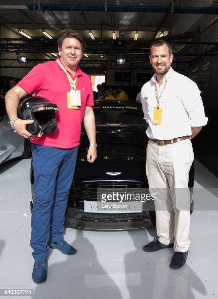 Chef and TV personality James Martin and Peter Philips prepare to be driven in an Aston Martin Vanquish S as part of F1 Hotlaps before the Bahrain...