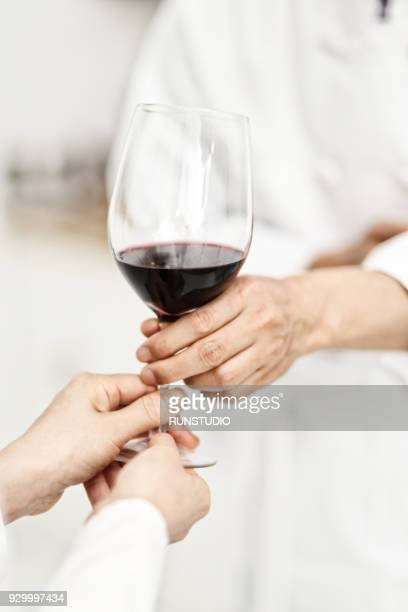 Chef and woman holding glass of wine