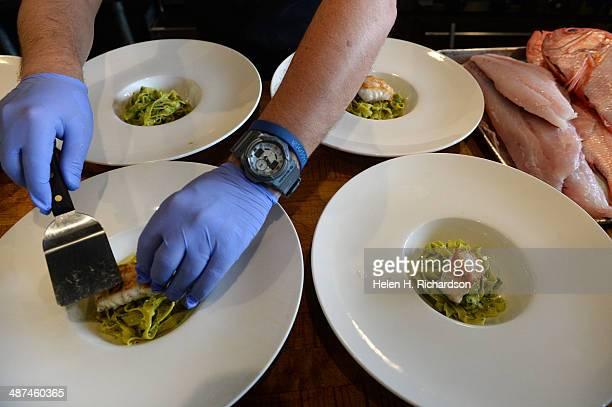 Chef Andrea Frizzi of Il Posto restaurant prepares a pasta dish of tagliatelle pasta with pesto ramps fresh garbanzo beans and fresh grouper from the...